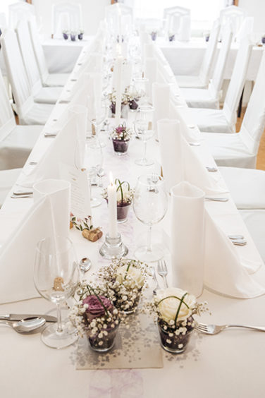 Floral wedding long table bouquets