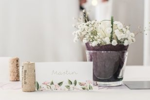 floral wedding seating tag and bouquet